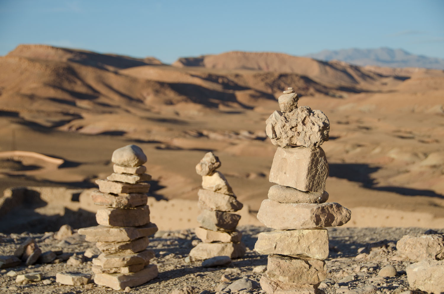 Image of cairns against a mountain